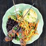 Seitan Satay on a green plate with shredded salad