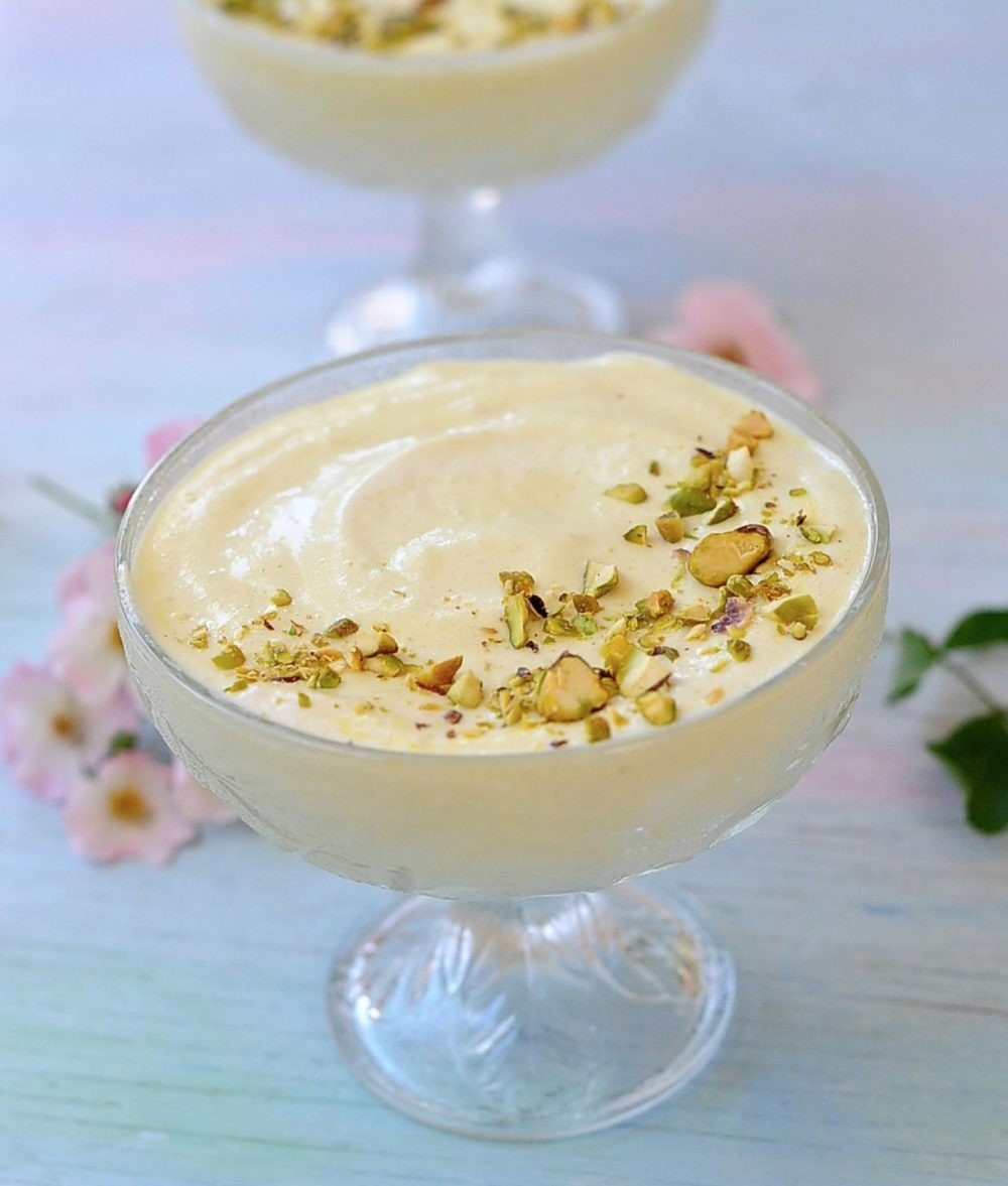 Lemon Mousse, Vegan, in glass bowls with pistachios and rosesLemon Mousse, Vegan, in glass bowls with pistachios and roses