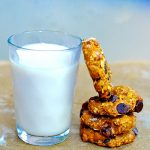 Pumpkin Pie Breakfast cookies stacked by a glass of soy milk