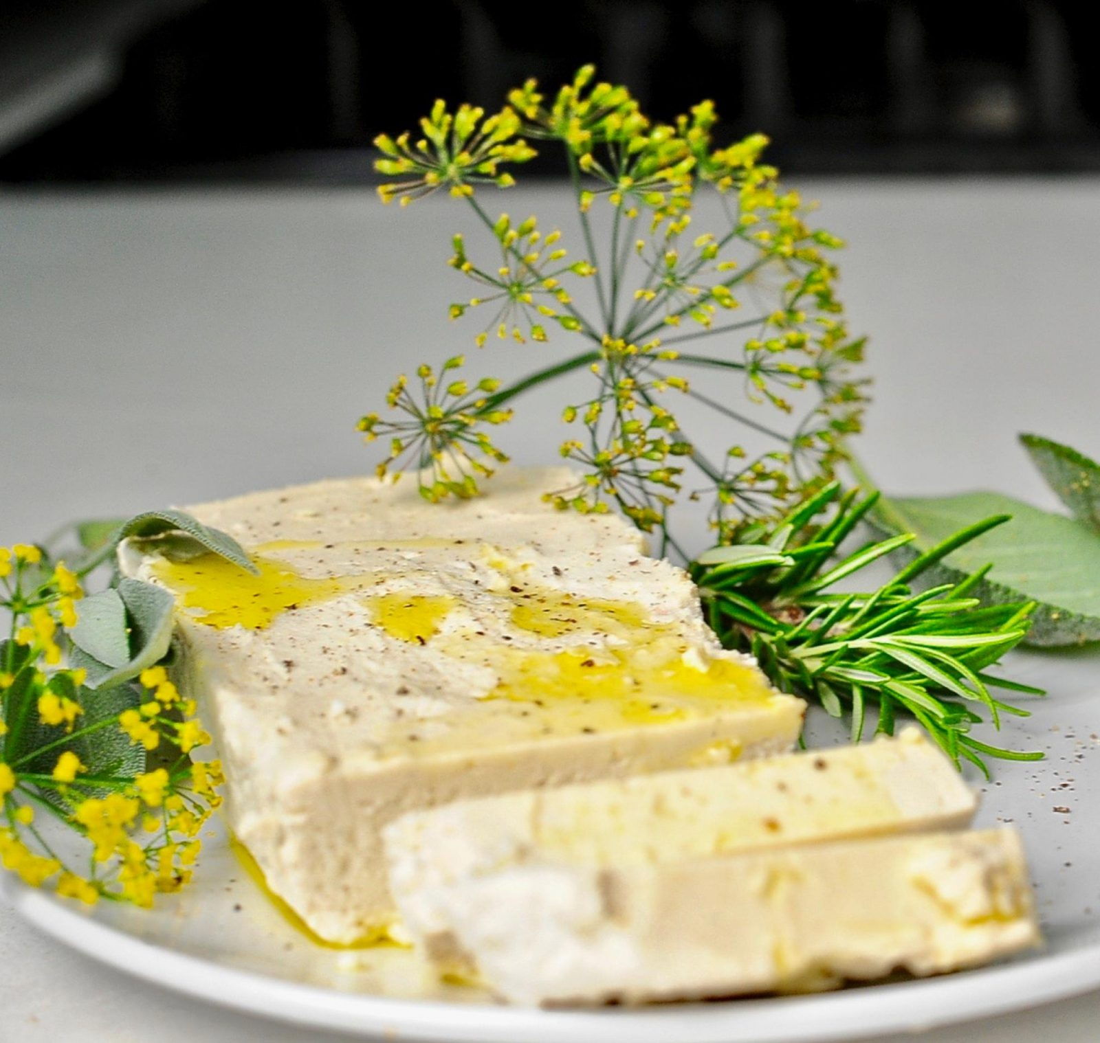 Vegan Almond Feta cheese with fresh herbs.