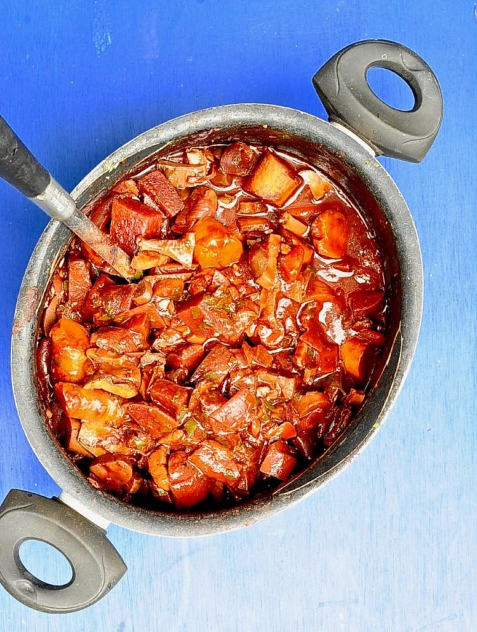 One Pot Beet Bourguignon (Vegan) on blue back round