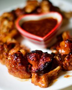Cauliflower wings piled with heart shaped bowl